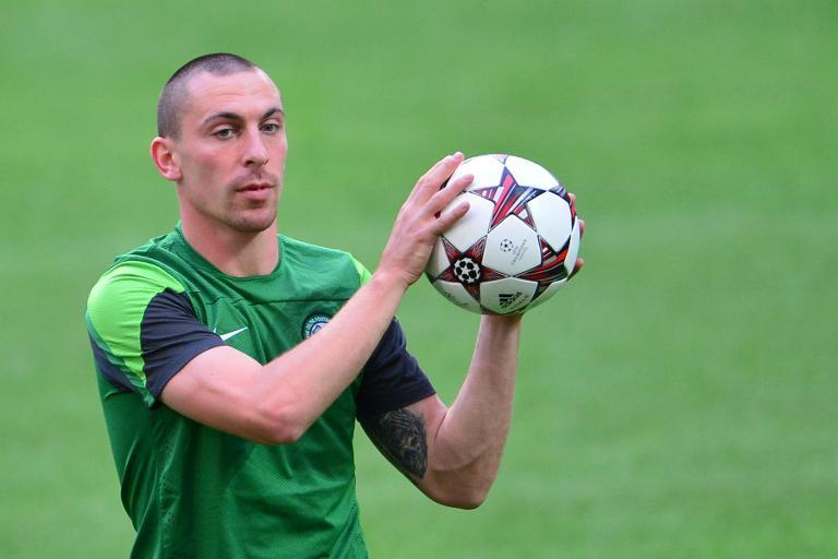Celtic captain Scott Brown trains at the San Siro Stadium in Milan on the eve of a Champions League match on September 17, 2013