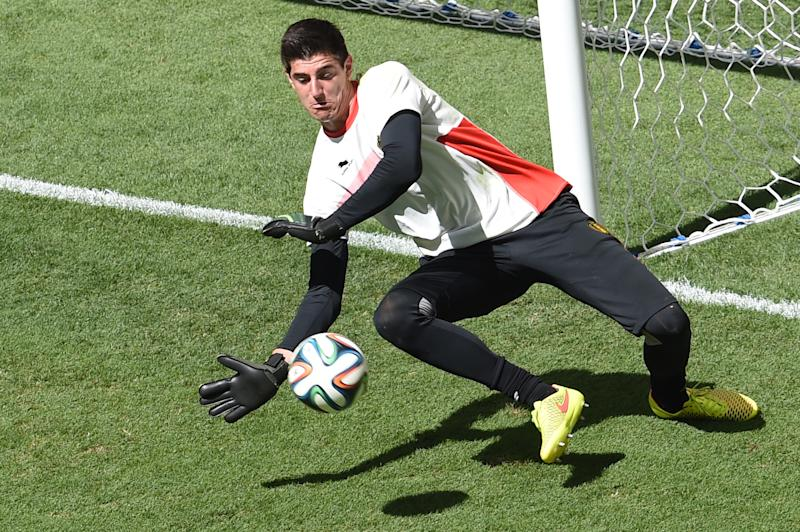 Belgium's goalkeeper Thibaut Courtois dives for the ball before a quarter-final match against Argentina at the Mane Garrincha National Stadium in Brasilia on July 5, 2014 during the 2014 FIFA World Cup