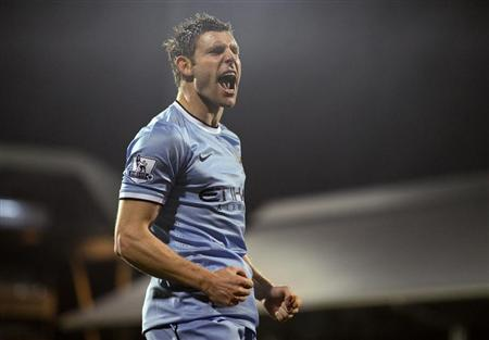Manchester City's Milner celebrates his goal against Fulham during their English Premier League soccer match in London