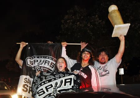 San Antonio Spurs fans celebrate after the Spurs beat the Miami Heat to win their fifth NBA Championship, in San Antonio