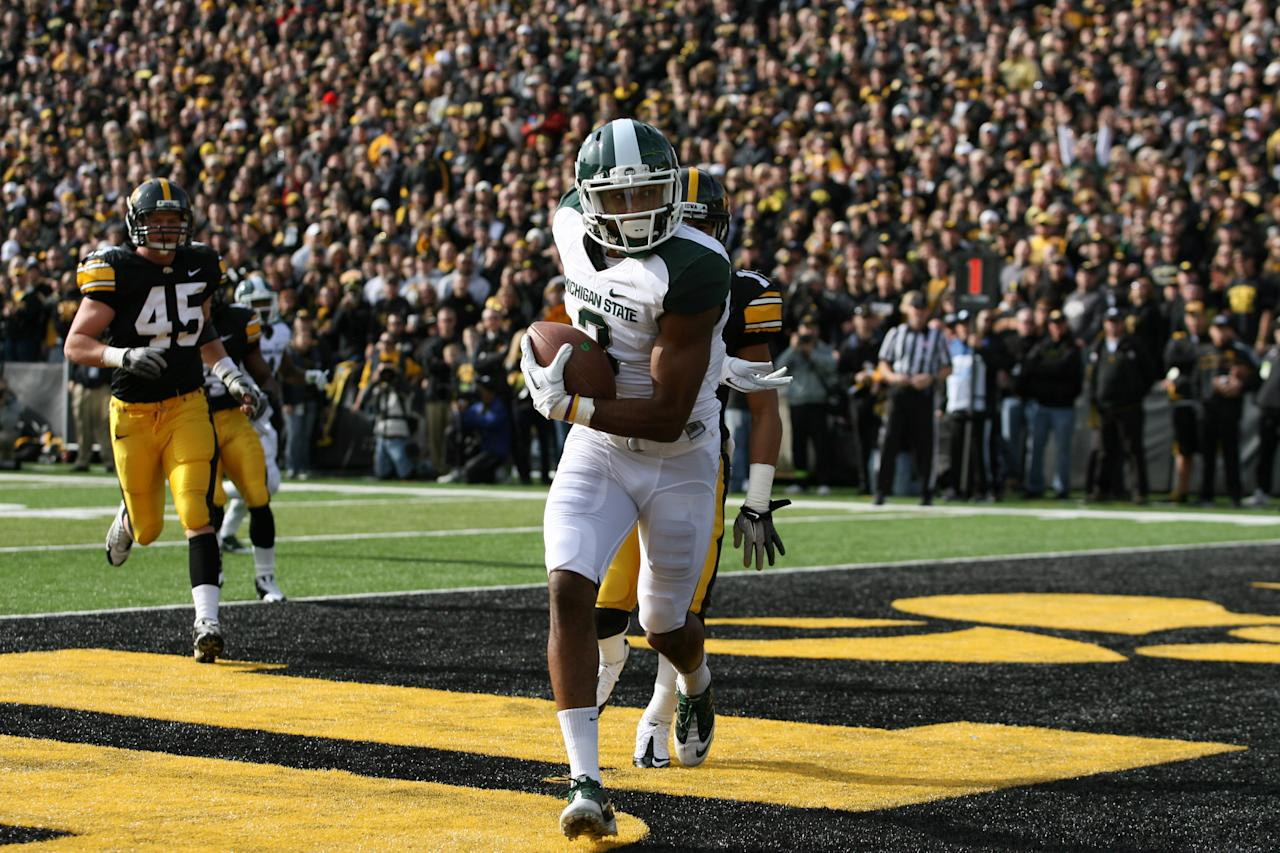 IOWA CITY, IA - NOVEMBER 12:   B. J. Cunningham #3 of the Michigan State Spartans scores a touchdown against the Iowa Hawkeyes at Kinnick Stadium November 12, 2011 in Iowa City, Iowa.  (Photo by Reese Strickland/Getty Images)