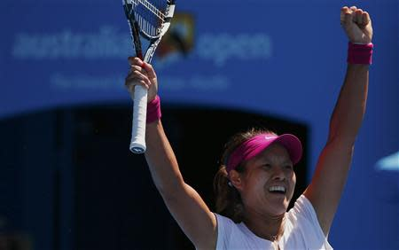 Li Na of China celebrates defeating Eugenie Bouchard of Canada in their women's singles semi-final match at the Australian Open 2014 tennis tournament in Melbourne