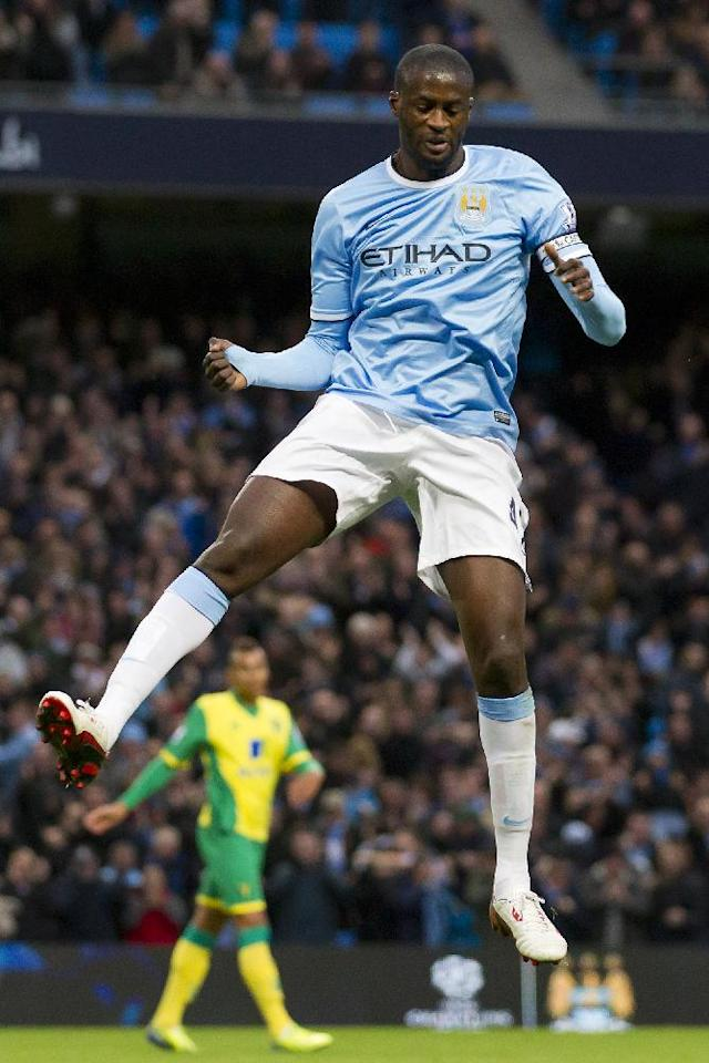 Manchester City's Yaya Toure celebrates after scoring against Norwich during their English Premier League soccer match at the Etihad Stadium, Manchester, England, Saturday Nov. 2, 2013. (AP Photo/Jon Super)