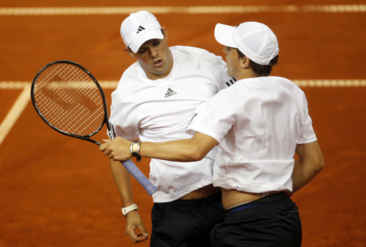 Brothers Bob, and Mike Bryan, left, of US team react after defeating Roko Karanusic and Lovro Zovko of Croatian team in their Davis Cup quarterfinal doubles tennis match, in Porec, Croatia, Saturday, July 11, 2009. (AP Photo/Darko Bandic)