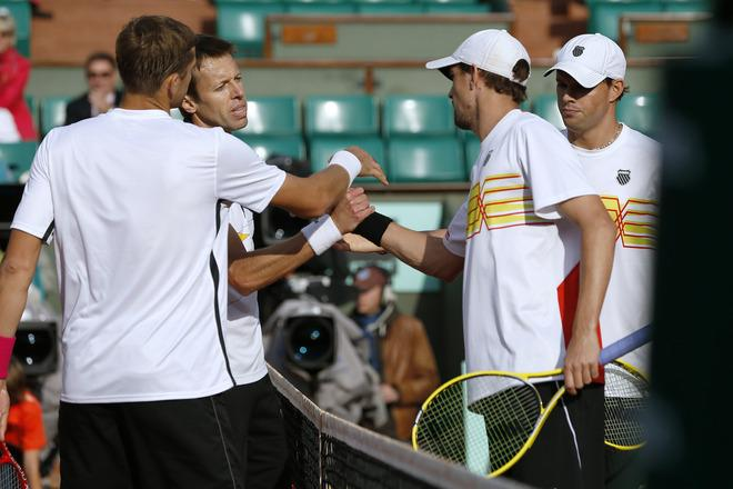 US Bob Bryan (2ndR) and US Mike Bryan (R) shake hands with Belarus Max Mirnyi (L) and Canada's Daniel Nestor (2ndL) after Men's Doubles final tennis match of the French Open tennis tournament at the Roland Garros stadium, on June 9, 2012 in Paris. Belarus Max Mirnyi and Canada's Daniel Nestor  won.  AFP PHOTO / THOMAS COEXTHOMAS COEX/AFP/GettyImages