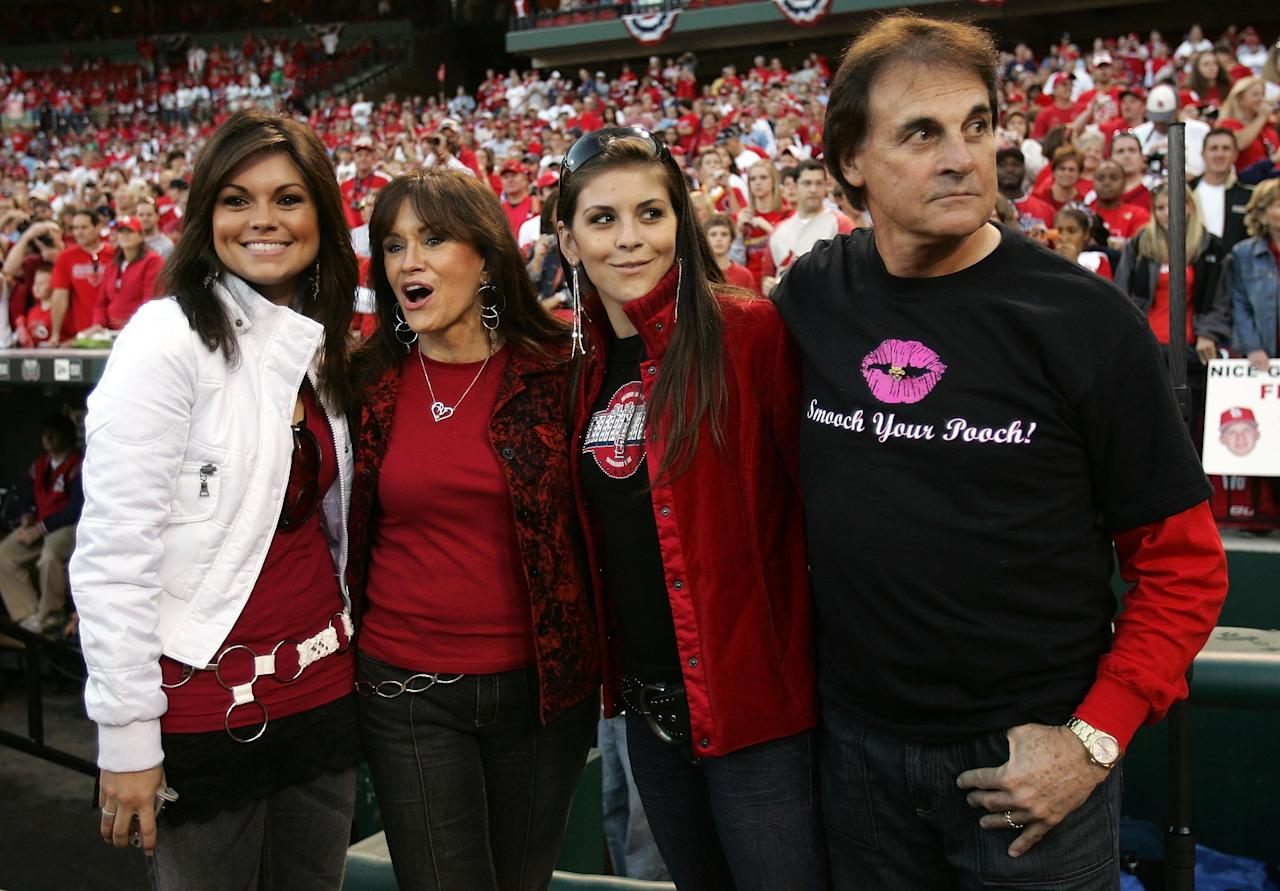 ST LOUIS, MO - OCTOBER 29:  Tony LaRussa (R) and his family stand on the field during the St. Louis Cardinals World Series Victory Parade and Rally at Busch Stadium on October 29, 2006 in St. Louis, Missouri.  (Photo by Elsa/Getty Images)