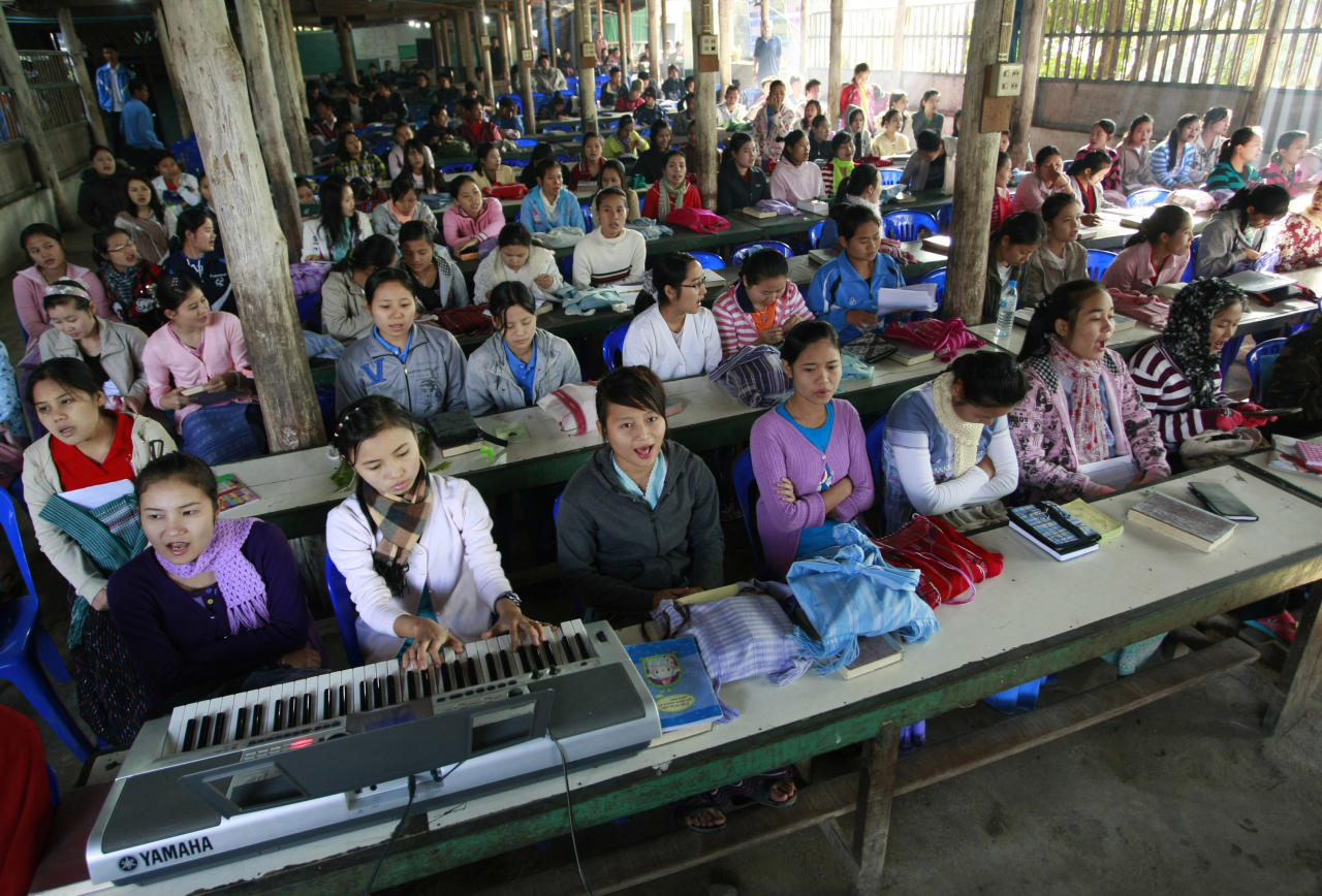 In this photo taken Thursday, jan. 19, 2012, young Karen refugees attend a morning church service inside Mae La refugee camp in Tha Song Yang district, Tak province northern Thailand. Surprisingly rapid reforms and cease-fires under way in Myanmar are opening the prospects for the return of one of the world's largest refugee populations _ some 1 million Burmese huddled in frontier camps and hide-outs across five countries. (AP Photo/Apichart Weerawong)
