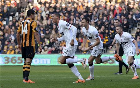 Manchester United's Smalling celebrates after scoring a goal against Hull City during their English Premier League soccer match in Hull