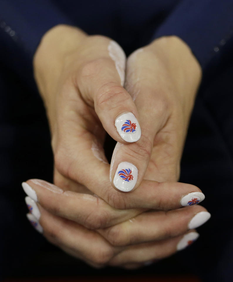 Britain's Victoria Pendleton sports fingernails painted in the British national colors prior to competing in a track cycling women's sprint event, during the 2012 Summer Olympics, Sunday, Aug. 5, 2012, in London. (AP Photo/Matt Rourke)