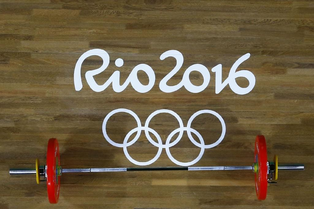 International Weightlifting Federation has adopted a resolution that any country returning three or more positive drugs tests from the last two Olympics will be suspended for a year (AFP Photo/Stoyan Nenov)