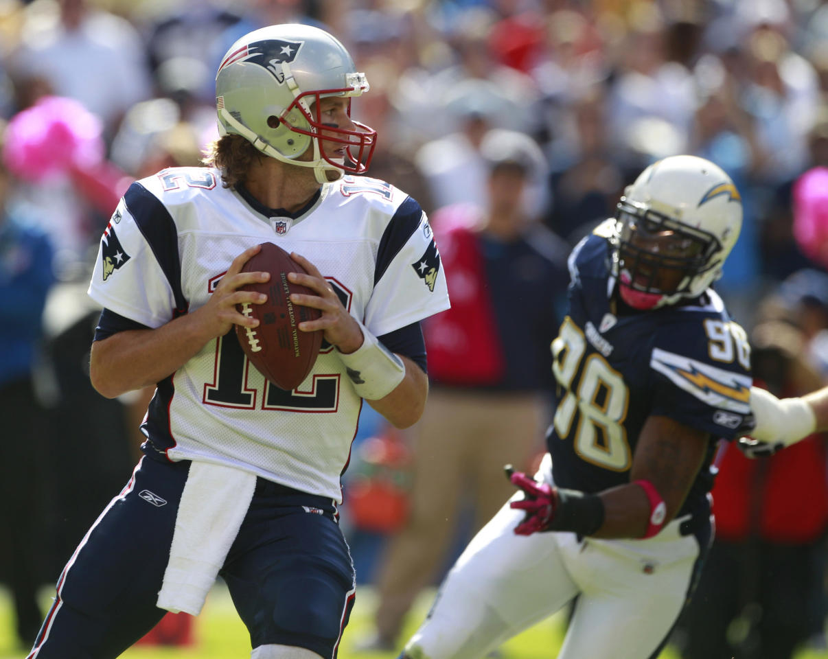 New England Patriots quarterback Tom Brady looks to pass against the San Diego Chargers in the first half during an NFL football game Sunday, Oct. 24, 2010, in San Diego.
