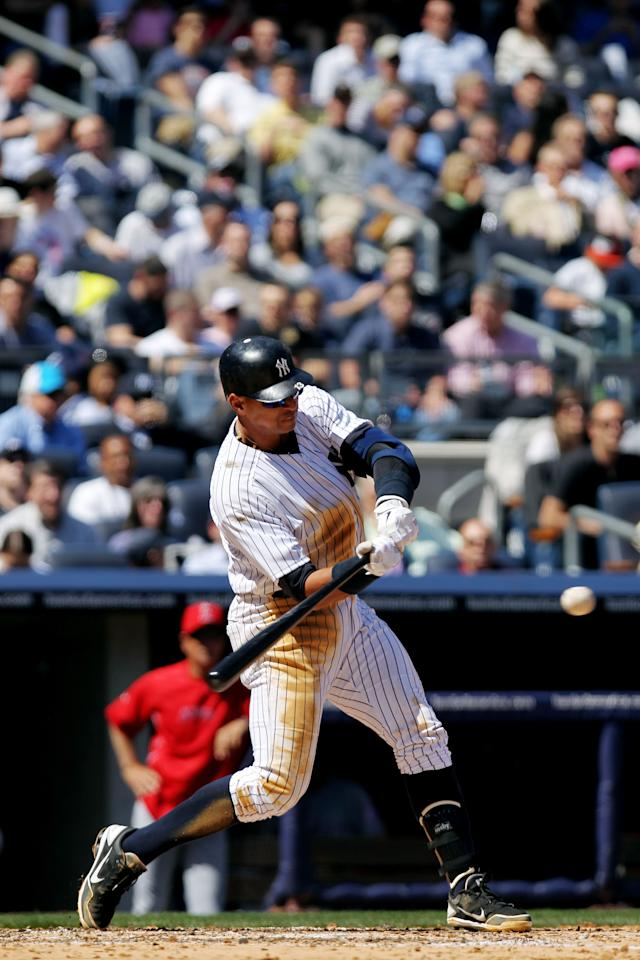 NEW YORK, NY - APRIL 13:  Alex Rodriguez #13 of the New York Yankees hits a solo home run in the third inning against the Los Angeles Angels during the home opener at Yankee Stadium on April 13, 2012 in the Bronx borough of New York City.  (Photo by Nick Laham/Getty Images)