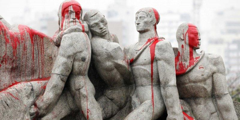 statues covered in blood paint