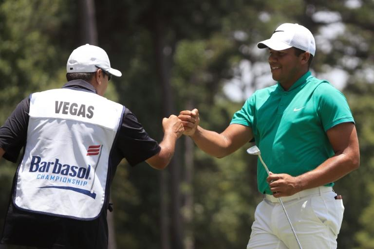 Jhonattan Vegas of Venezuela celebrates with his caddie on the eighth green during the second round of the Barbasol Championship, at the Robert Trent Jones Golf Trail at Grand National in Auburn, Alabama, on July 15, 2016