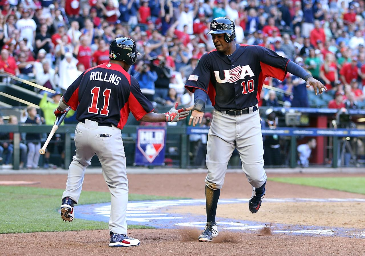 PHOENIX, AZ - MARCH 10:  Adam Jones #10 of USA celebrates with Jimmy Rollins #11 after scoring a run against Canada during the eighth inning of the World Baseball Classic First Round Group D game at Chase Field on March 10, 2013 in Phoenix, Arizona. USA defeated Canada 9-4. (Photo by Christian Petersen/Getty Images)