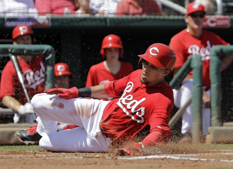 Defending champ Cards open against depleted Reds