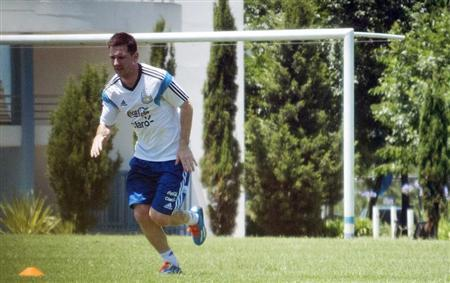 Argentine striker Messi jogs during a training session in Buenos Aires
