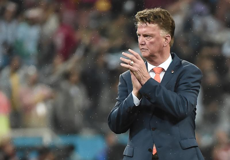 Netherlands' coach Louis van Gaal applauds after the semi-final football match between Netherlands and Argentina of the FIFA World Cup at The Corinthians Arena in Sao Paulo on July 9, 2014