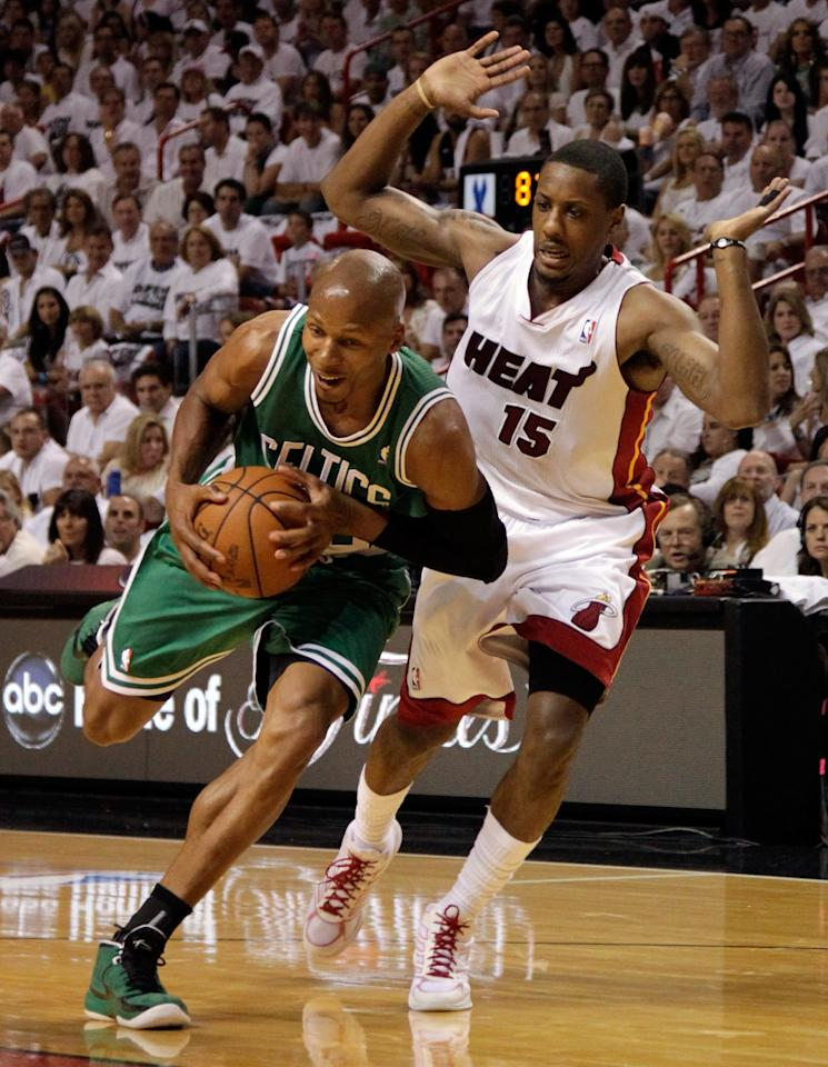 MIAMI, FL - JUNE 09:  Ray Allen #20 of the Boston Celtics drives on Mario Chalmers #15 of the Miami Heat in the first quarter in Game Seven of the Eastern Conference Finals in the 2012 NBA Playoffs on June 9, 2012 at American Airlines Arena in Miami, Florida. NOTE TO USER: User expressly acknowledges and agrees that, by downloading and or using this photograph, User is consenting to the terms and conditions of the Getty Images License Agreement.  (Photo by Mike Ehrmann/Getty Images)