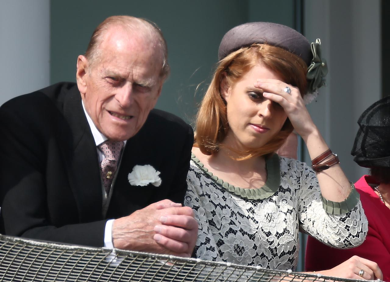 EPSOM, ENGLAND - JUNE 02:  Prince Philip, Duke of Edinburgh and Princess Beatrice watch The Derby on June 2, 2012 in Epsom, England. For only the second time in its history, the UK celebrates the Diamond Jubilee of a monarch. Her Majesty Queen Elizabeth II celebrates the 60th anniversary of her ascension to the throne. Thousands of wellwishers from around the world have flocked to London to witness the spectacle of the weekend's celebrations. The Queen along with all the members of the royal family will participate in a River Pageant with a flotilla of 1,000 boats accompanying them down the Thames, a star studded free concert at Buckingham Palace, and a carriage procession and a Service of Thanksgiving at St Paul's Cathedral.  (Photo by Peter Macdiarmid/Getty Images)