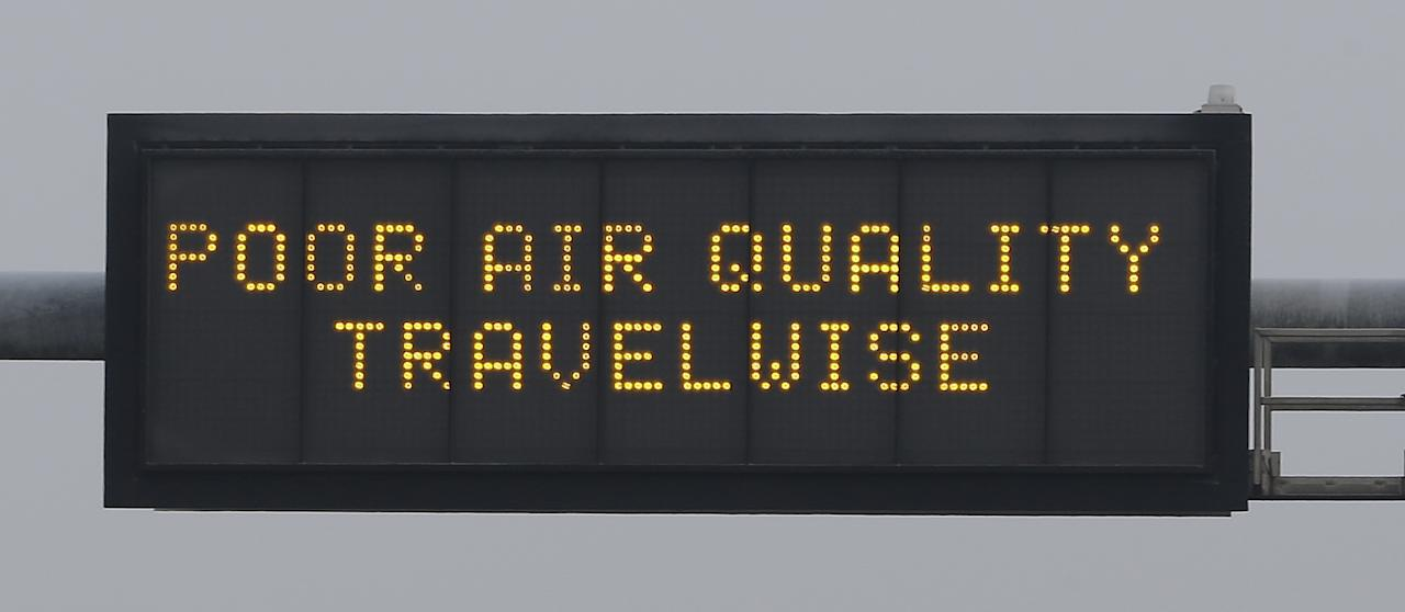 A poor air quality warning is posted over a highway Wednesday, Jan. 23, 2013, in Salt Lake City. A group of doctors is declaring a health emergency over northern Utah's lingering pollution problem. Utah Physicians for a Healthy Environment planned to deliver a petition Wednesday demanding immediate action by elected officials. (AP Photo/Rick Bowmer)