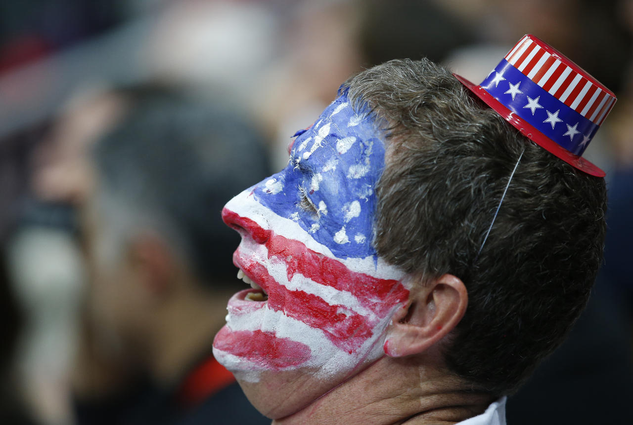 A fan cheers for Team USA during the first half of an of a preliminary men's basketball game France at the 2012 Summer Olympics, Friday, July 27, 2012, in London. (AP Photo/Jae C. Hong)