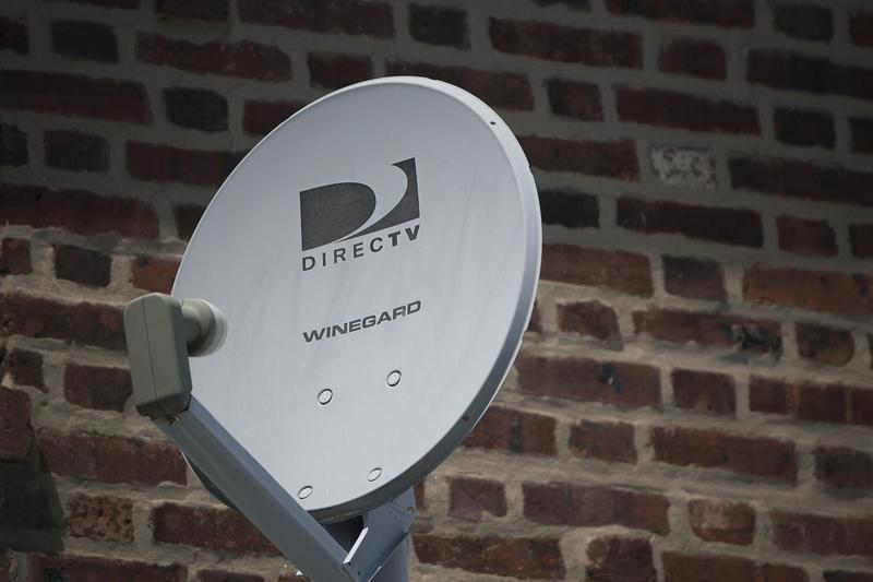 A Direct TV dish is seen outside a home in the Queens borough of New York