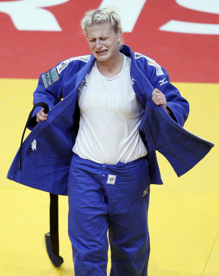 Kayla Harrison of the U.S. reacts after winning her under 78kg women's bronze medal bout against Marhinde Verkerk of the Netherlands at the World Judo Championships in Paris August 26, 2011.   REUTERS/Yves Herman (FRANCE  - Tags: SPORT JUDO)