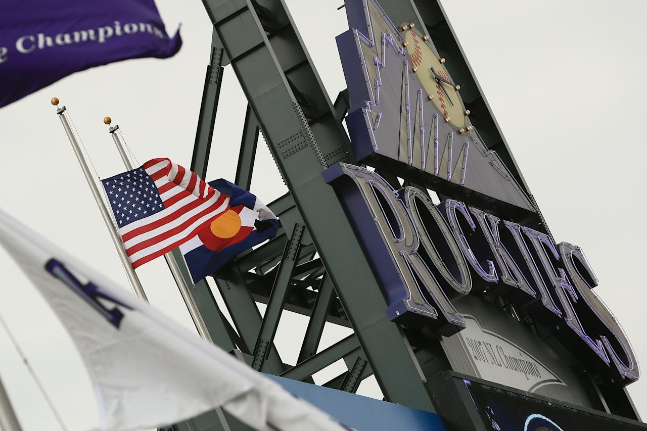 DENVER, CO - APRIL 16:  The American Flag flys at half mast in honor of the victims of the ragedy at the Boston Marathon as the New York Mets face the Colorado Rockies at Coors Field on April 16, 2013 in Denver, Colorado. All uniformed team members are wearing jersey number 42 in honor of Jackie Robinson Day.  (Photo by Doug Pensinger/Getty Images)