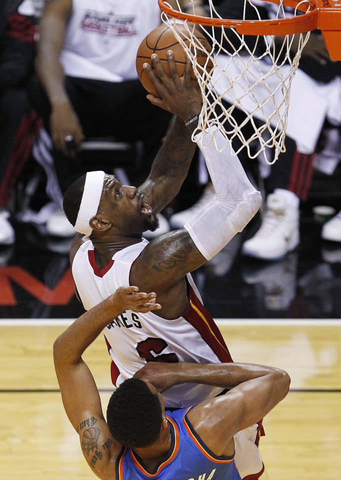 Miami Heat small forward LeBron James (6) shoots over Oklahoma City Thunder shooting guard Thabo Sefolosha (2) of Switzerland during the first half at Game 5 of the NBA finals basketball series, Thursday, June 21, 2012, in Miami. (AP Photo/Wilfredo Lee)