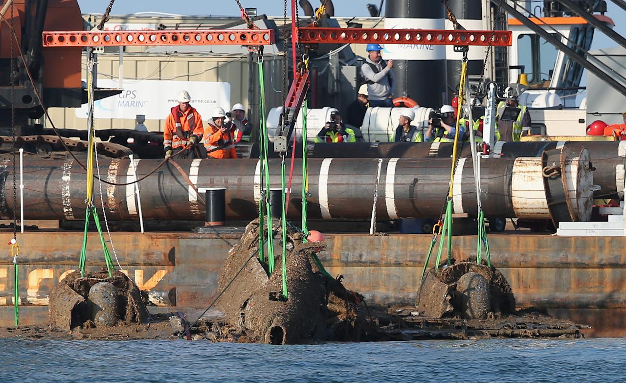 RAMSGATE, ENGLAND - JUNE 10:  A World War II Dornier 17 aircraft is lifted from waters of the English Channel on June 10, 2013 near Ramsgate, England. The salvage is planned through the RAF Museum to lift the only remaining German bomber Dornier 17, used during the 'Battle of Britain' of 1940. The plane on the Goodwin Sands is believed to be aircraft call-sign 5K-AR, shot down on August 26, 1940 at the height of the battle by RAF Boulton-Paul Defiant fighters. The Project has suffered many delays due to poor weather. Once recovered, the aircraft will be preserved and put on displayed for the public at the museum's Hendon base in north London.  (Photo by Peter Macdiarmid/Getty Images)