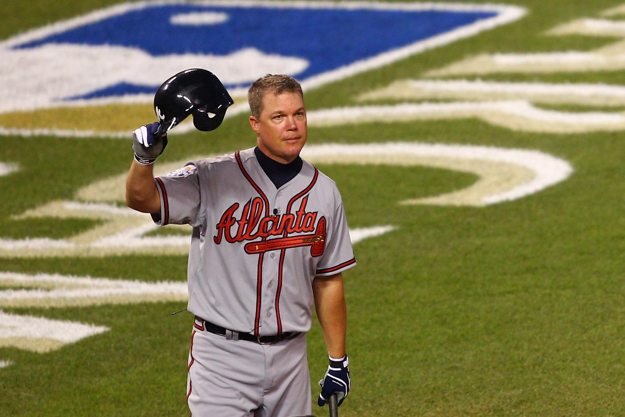 KANSAS CITY, MO - JULY 10:  National League All-Star Chipper Jones #10 of the Atlanta Braves takes off his helmet and waves to the crowd during his at bat in the sixth inning during the 83rd MLB All-Star Game at Kauffman Stadium on July 10, 2012 in Kansas City, Missouri.  (Photo by Dilip Vishwanat/Getty Images)