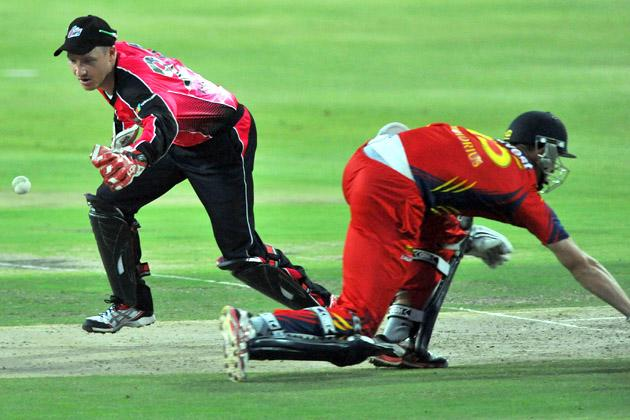 Dwaine Pretorius (R) of the Lions completes a run as Brad Haddin of the Sixers fumbles with  the ball during the Karbonn Smart CLT20 Final match between bizhub Highveld Lions and Sydney Sixers at Bidvest Wanderers Stadium on October 28, 2012 in Johannesburg, South Africa. (Photo by Duif du Toit/Gallo Images/Getty Images)