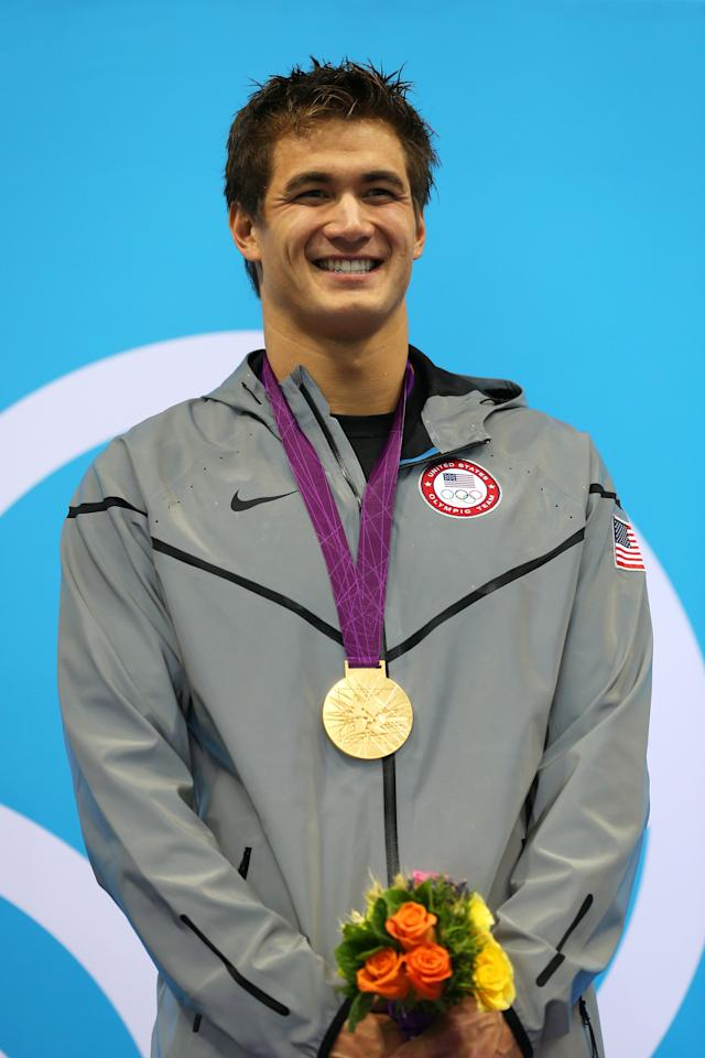 LONDON, ENGLAND - AUGUST 01:  Gold medalist Nathan Adrian of the United States celebrates with his medal on the podium during the medal cermony for the Men's 100m Freestyle on Day 5 of the London 2012 Olympic Games at the Aquatics Centre on August 1, 2012 in London, England.  (Photo by Clive Rose/Getty Images)