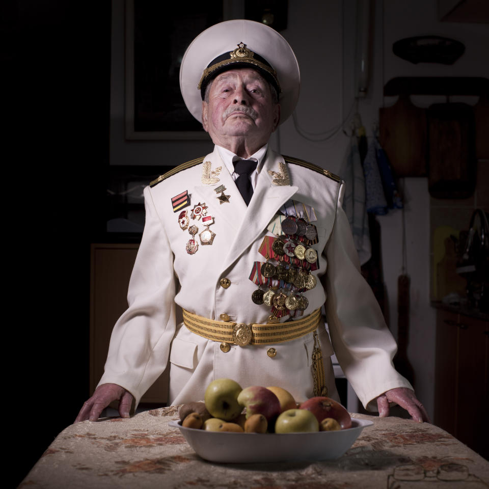 In this photo made on Thursday, April 11, 2013, Soviet Jewish World War Two veteran Yaakov Vilkovich, 90, poses for a portrait at his house in the southern Israeli city of Ashdod. Vilkovich joined the Red Army in 1941, served in the 31st Army's infantry battalion and fought in the Battle of Berlin in 1945. He immigrated to Israel in 1998. About 500,000 Soviet Jews served in the Red Army during World War Two, and the majority of those still alive today live in Israel. (AP Photo/Oded Balilty)