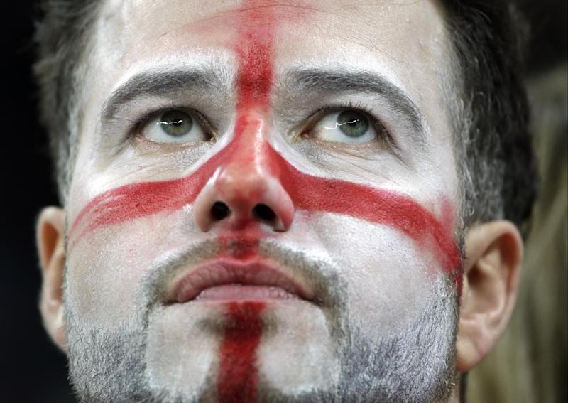 An England fan reacts following Uruguay's 2-1 victory over England in the group D World Cup soccer match between Uruguay and England at the Itaquerao Stadium in Sao Paulo, Brazil, Thursday, June 19, 2014