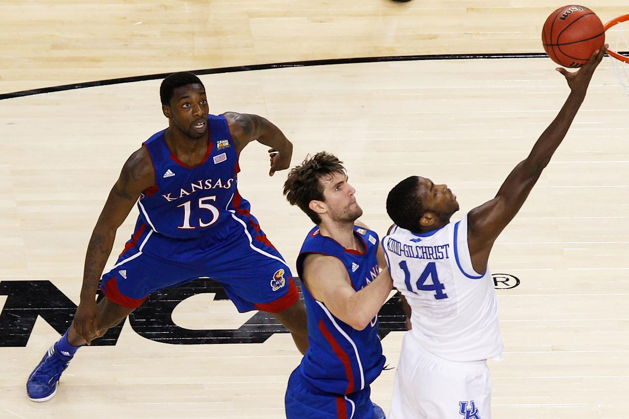 Michael Kidd-Gilchrist #14 of the Kentucky Wildcats lays the ball up in front of Jeff Withey #5 of the Kansas Jayhawks in the first half in the National Championship Game of the 2012 NCAA Division I Men's Basketball Tournament at the Mercedes-Benz Superdome on April 2, 2012 in New Orleans, Louisiana. (Photo by Chris Graythen/Getty Images)