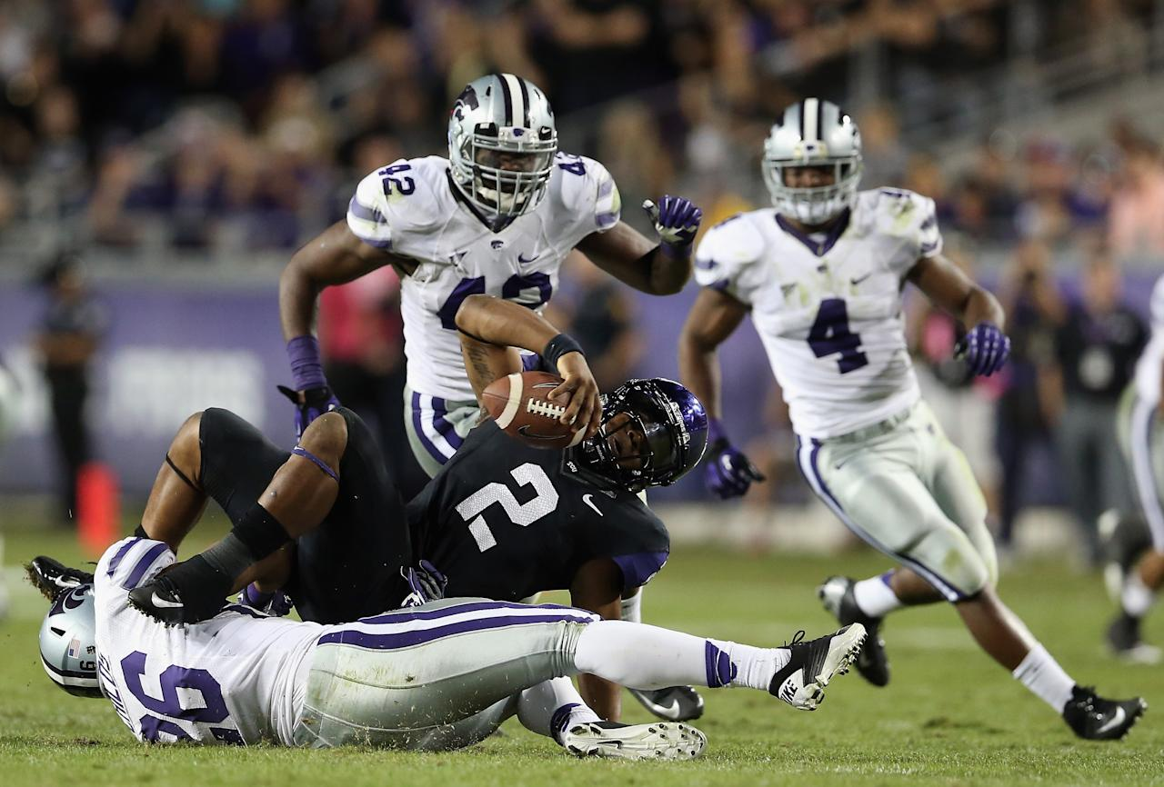 FORT WORTH, TX - NOVEMBER 10:  Trevone Boykin #2 of the TCU Horned Frogs is sacked by Jarell Childs #26 of the Kansas State Wildcats at Amon G. Carter Stadium on November 10, 2012 in Fort Worth, Texas.  (Photo by Ronald Martinez/Getty Images)
