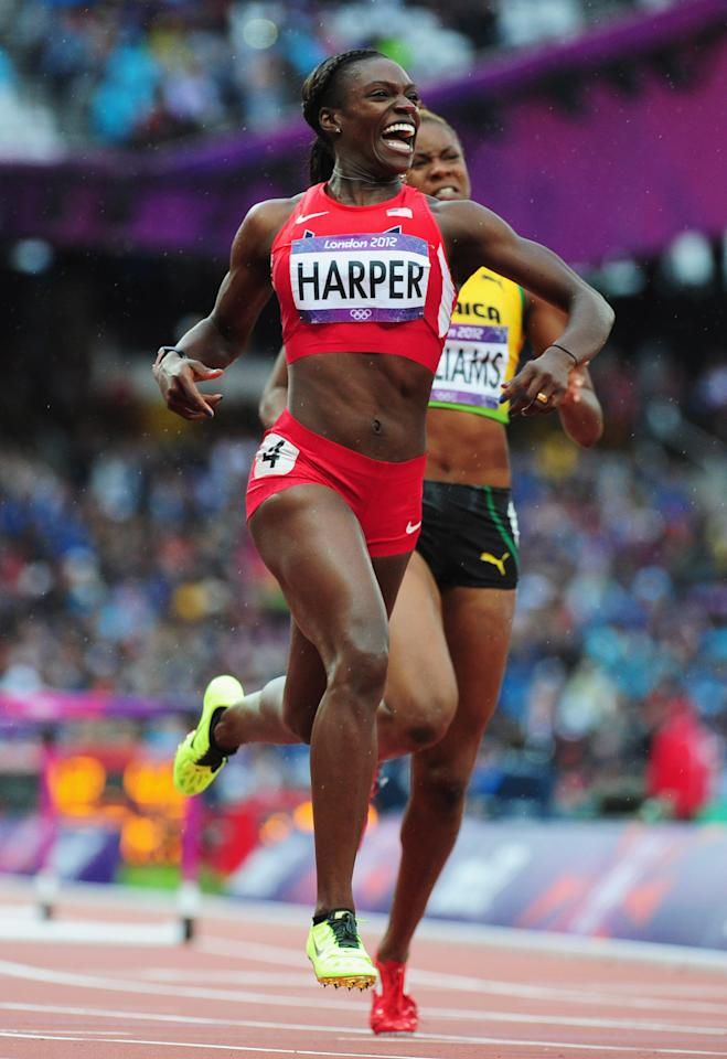 LONDON, ENGLAND - AUGUST 07:  Dawn Harper of the United States leads Shermaine Williams of Jamaica in the Women's 100m Hurdles Semifinals on Day 11 of the London 2012 Olympic Games at Olympic Stadium on August 7, 2012 in London, England.  (Photo by Stu Forster/Getty Images)