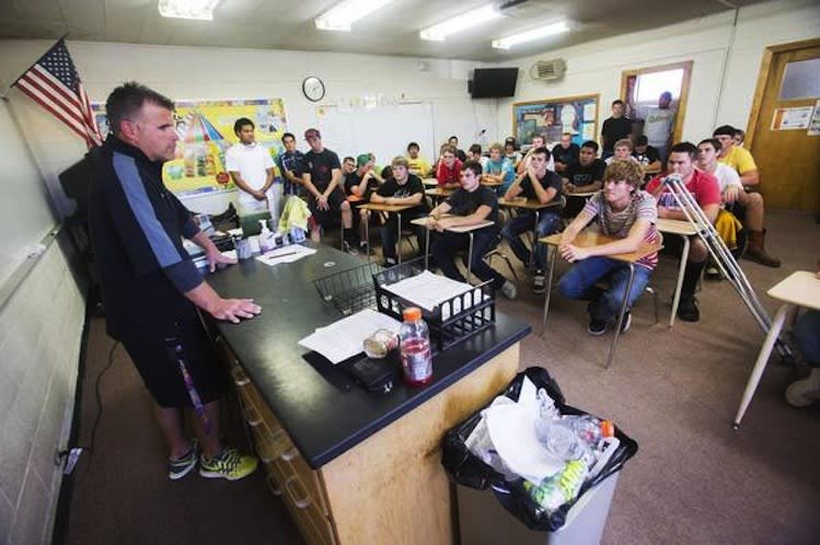 Union High football coach Matt Labrum speaks to his players after a community service outing — Deseret News