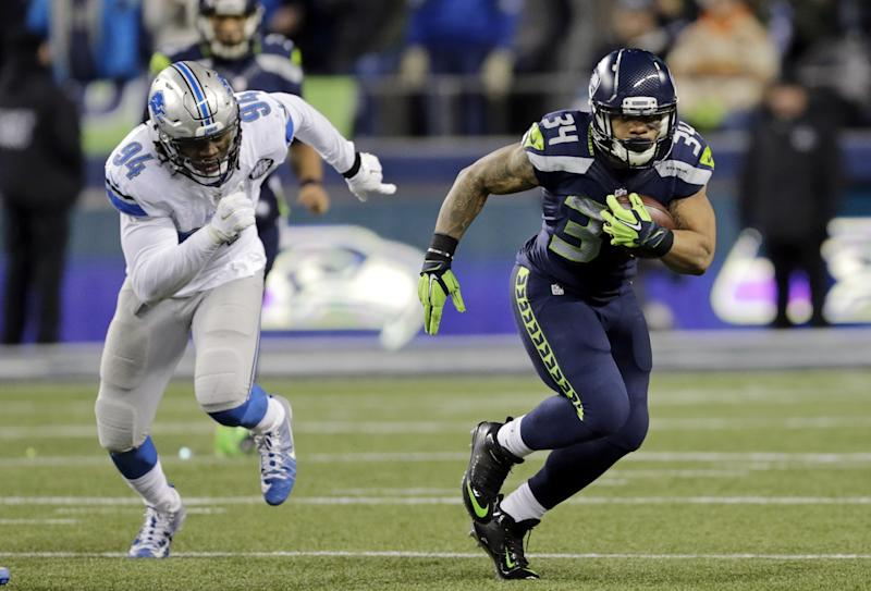 Thomas Rawls set a Seattle franchise record for rushing yards in a postseason game vs. Detroit. (AP)
