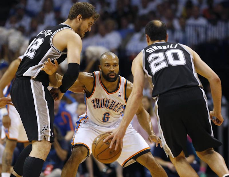 Oklahoma City Thunder guard Derek Fisher (6) defends between San Antonio Spurs guard Manu Ginobili (20) and Tiago Splitter during the first half of Game 6 of the Western Conference finals NBA basketball playoff series ,in Oklahoma City, Saturday, May 31, 2014