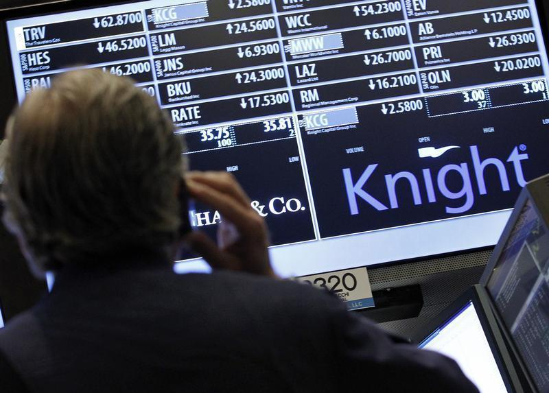 A trader stands by the post that trades Knight Capital on the floor of the New York Stock Exchange