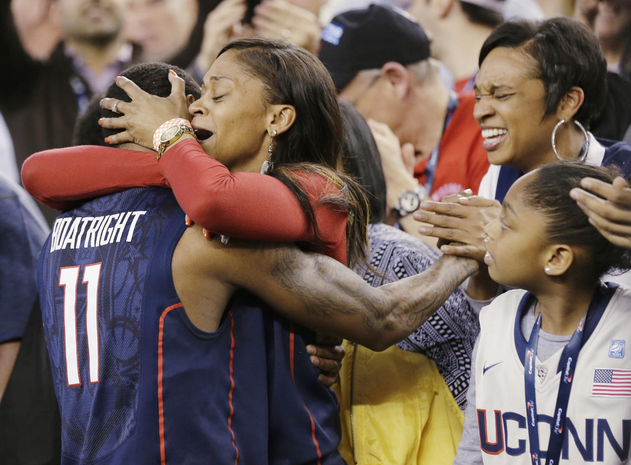 Connecticut guard Ryan Boatright (11) gets a hug after his team beat Florida 63-53 at their NCAA Final Four tournament college basketball semifinal game Saturday, April 5, 2014, in Arlington, Texas. (AP Photo/Eric Gay)