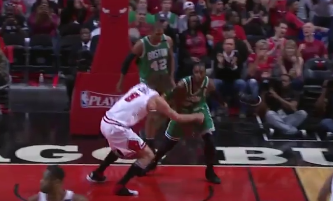 Robin Lopez is out here tying opponent Jae Crowder's shoe