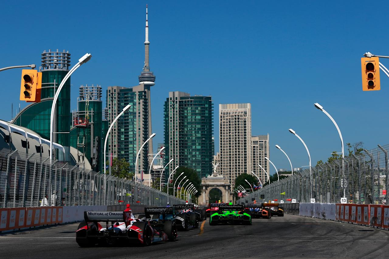 TORONTO, ON - JULY 13: A pack of cars race during the IZOD INDYCAR Series Honda Indy Toronto Race #1 on July 13, 2013 in Toronto, Canada. (Photo by Chris Trotman/Getty Images)