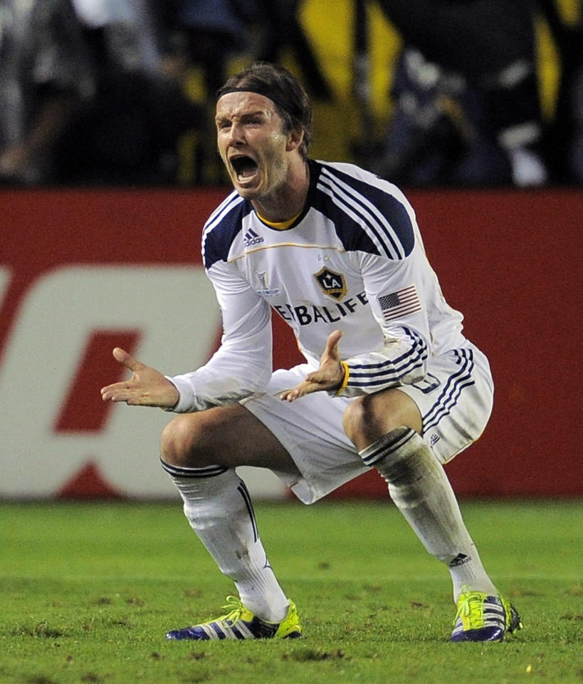 Los Angeles Galaxy midfielder David Beckham celebrates a goal by forward Landon Donovan during the second half of their MLS Cup championship soccer match against the Houston Dynamo, Sunday, Nov. 20, 2011, in Carson, Calif. The Galaxy won 1-0. (AP Photo/Mark J. Terrill)