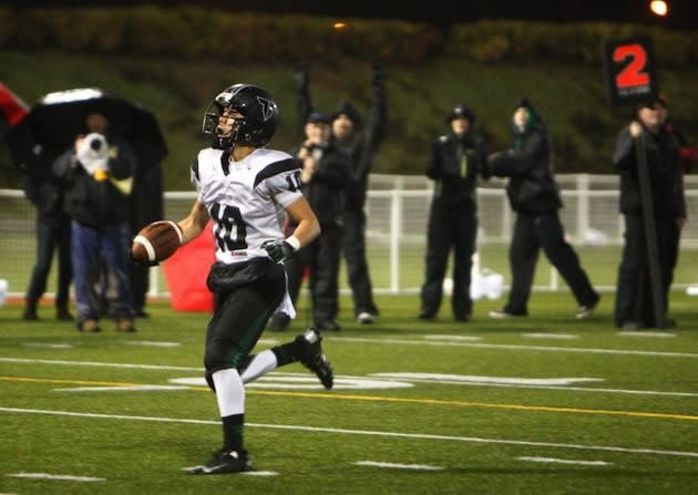 Manu Rasmussen scores an uncontested touchdown which nearly cost his Tigard team a playoff win — The Oregonian