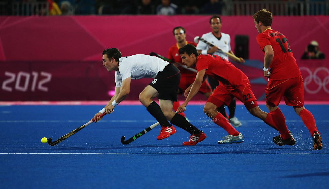 LONDON, ENGLAND - JULY 30:  Christopher Wesley of Germany is challenged by Simon Gougnard of Belgium during the Men's Hockey Match between Belgium and Germany on Day 3 of the London 2012 Olympic Games at the Riverbank Arena on July 30, 2012 in London, England.  (Photo by Daniel Berehulak/Getty Images)