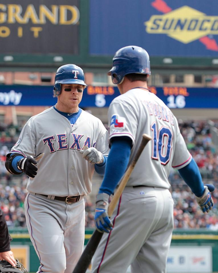 DETROIT, MI - APRIL 22:  Josh Hamilton #32 of the Texas Rangers hits a first inning solo home run and is congratulated by teammate Michael Young #10 during the game against the Detroit Tigers at Comerica Park on April 22, 2012 in Detroit, Michigan.  (Photo by Leon Halip/Getty Images)